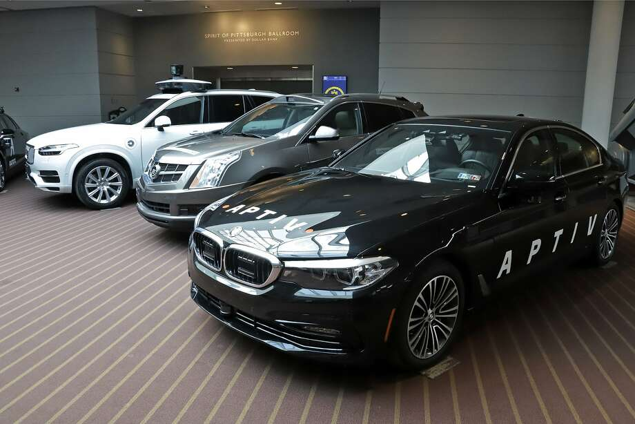 An autonomous Volvo under development by Uber (left) is among those displayed this month in Pittsburgh. The others are a Cadillac designed by Carnegie-Mellon University and a BMW designed by Apt. Photo: Gene J. Puskar / Associated Press