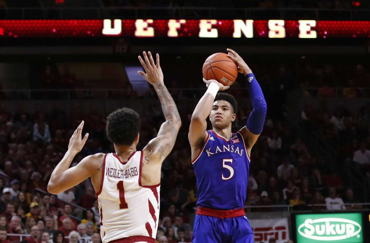AMES, IA - JANUARY 5: Quentin Grimes #5 of the Kansas Jayhawks takes a shot as Nick Weiler-Babb #1 of the Iowa State Cyclones blocks in the second half of play at Hilton Coliseum on January 5, 2019 in Ames, Iowa. The Iowa State Cyclones won 77-60 over the Kansas Jayhawks. (Photo by David K Purdy/Getty Images)
