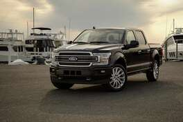 The Limited rolls on 22-inch alloy wheels and the grille is satin-finished as is the trim on tailgate, door handles and windows. (Ford photo)