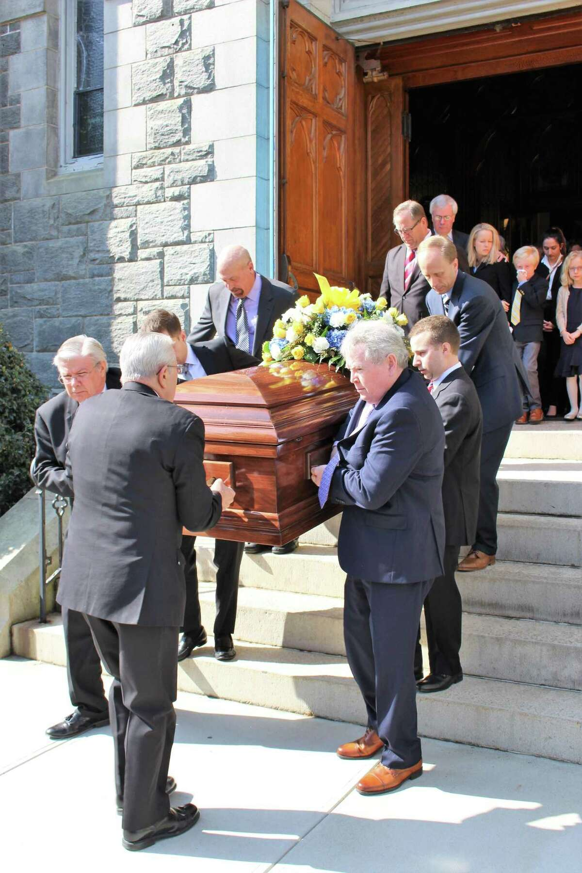 Pallbearers carry Karen Stanek's coffin from the Church of the Assumption in Ansonia Thursday. Stanek, a member of Seymour's Board of Selectman and a longtime Seymour High history teacher died March 8.