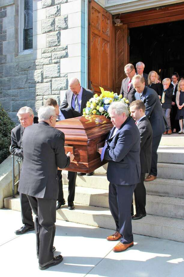 Pallbearers carry Karen Stanek's coffin from the Church of the Assumption in Ansonia Thursday. Stanek, a member of Seymour's Board of Selectman and a longtime Seymour High history teacher died March 8. Photo: / Jean Falbo-Sosnovich