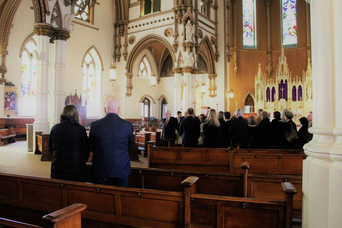 Friends and family members celebrate Karen Stanek's life during her Mass of Christian Burial Thursday in the Church of the Assumption in Ansonia. Stanek was a member of the Seymour Board of Selectmen when she died March 8.