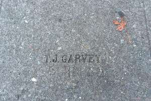 A stamp from concrete contractor T.J. Garvey, who laid out sidewalks in Berkeley and Oakland in the 1930s. This stamp is outside of Sack's Coffee House on College Ave. in Berkeley.