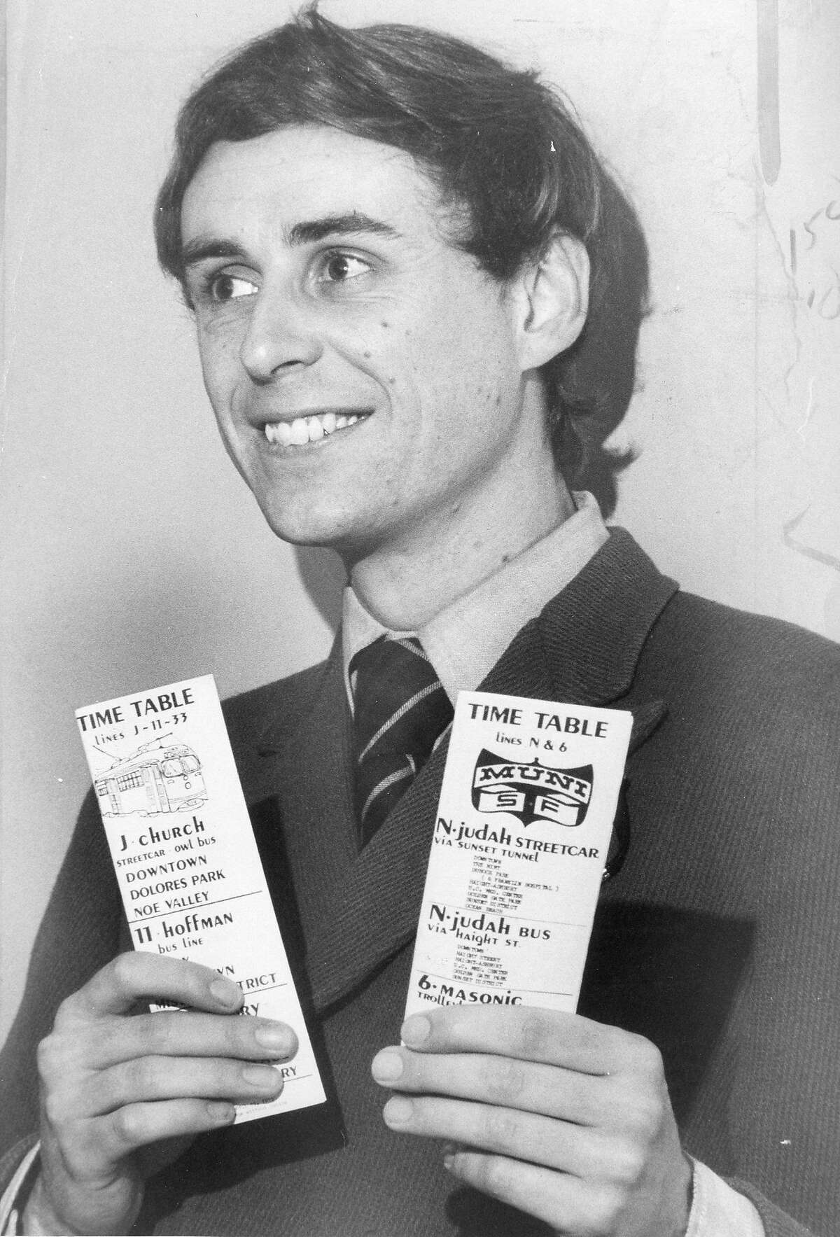 Muni driver Richard Morley shows off his self-printed Muni streetcar and bus schedules in August 1973.
