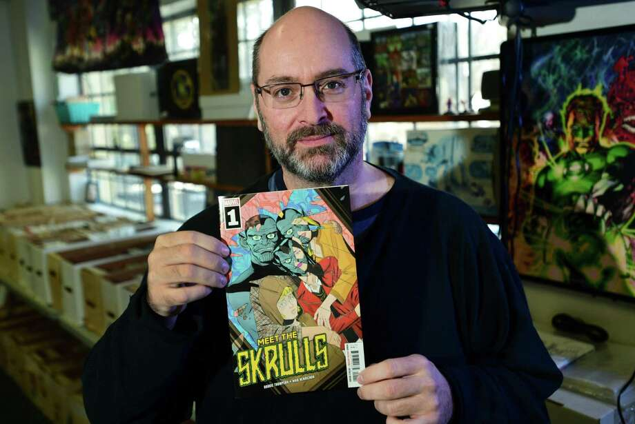 "Dave Kruseski, owner of Heroes Comics & Cards in Norwalk, displays the first issue of a new comic book series ""Meet the Skrulls,"" which takes place, at least partially, in Stamford. Photo: Erik Trautmann / Hearst Connecticut Media / Norwalk Hour"