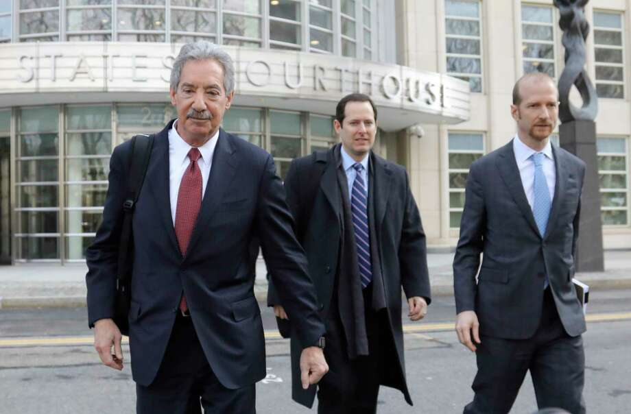 Lawyers for the Chinese electronics giant Huawei from left, James Cole, Michael Alexander Levy, and David Bitkower leave Brooklyn federal court in New York, Thursday March 14, 2019. Lawyers for Huawei have entered a not-guilty plea in a U.S. case charging the company with violating Iran trade sanctions. (AP Photo/Bebeto Matthews) Photo: Bebeto Matthews / AP