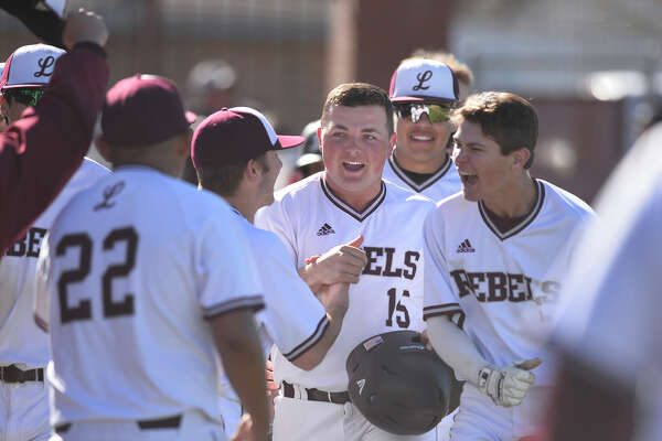 Lee's Austin Day (15) celebrates with teammates after hitting a home run against Odessa Permian March 14, 2019, at Ernie Johnson Field. James Durbin / Reporter-Telegram