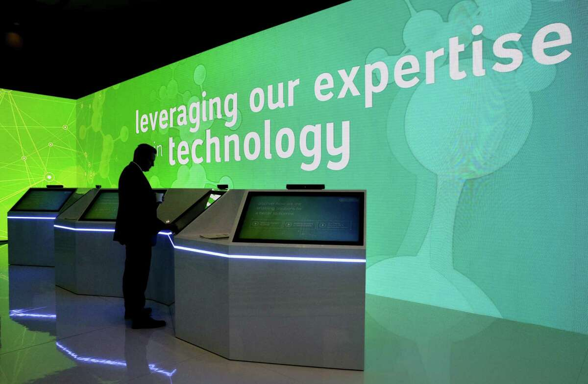 A conference attendant uses the touch screen displays and next to moving lit walls highlighting technologies in the Saudi Aramco room during the second day of CERAWeek by IHS Markit at the George R. Brown Convention Center Tuesday, Mar. 12, 2019 in Houston, TX.