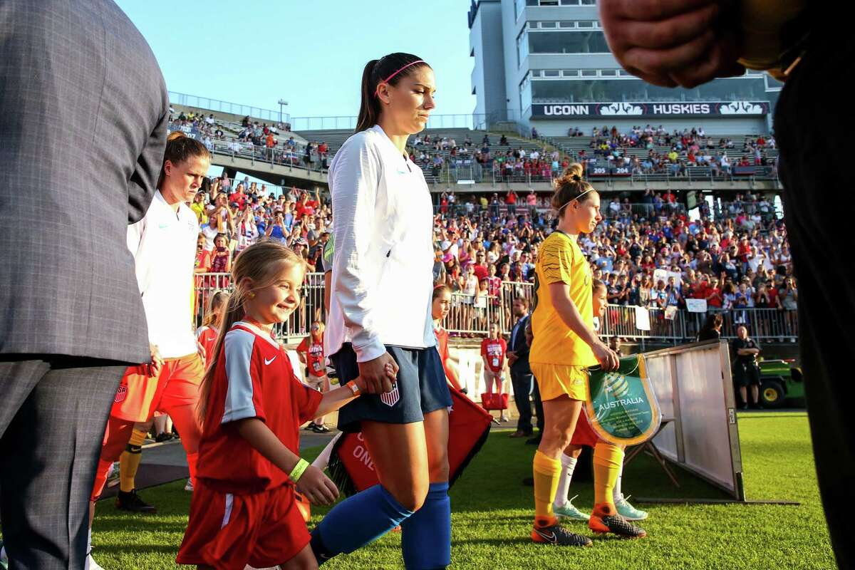 Alex Morgan of United States of America leads the teams out on the pitch during the Tournament of Nations match between Australia and United States of America at Pratt & Whitney Stadium in East Hartford, Connecticut on July 29, 2018.