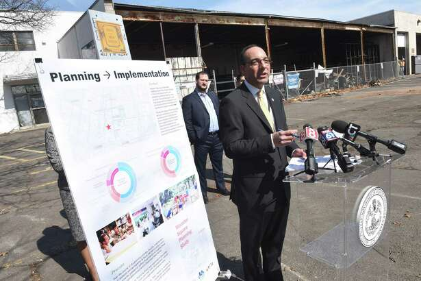 Acting New Haven Economic Development Officer Michael Piscitelli speaks at a groundbreaking for a Wooster Street redevelopment project slated to have 299 residential rental units and over 6,000 square feet of retail space on Union St. in New Haven. The developer applied for an assessment deferral.