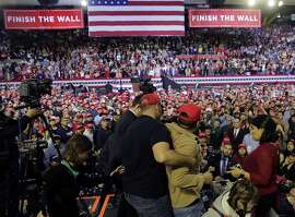 A man is restrained after he began shoving members of the media during a rally for President Donald Trump at the El Paso County Coliseum, Monday, Feb. 11, 2019, in El Paso, Texas.