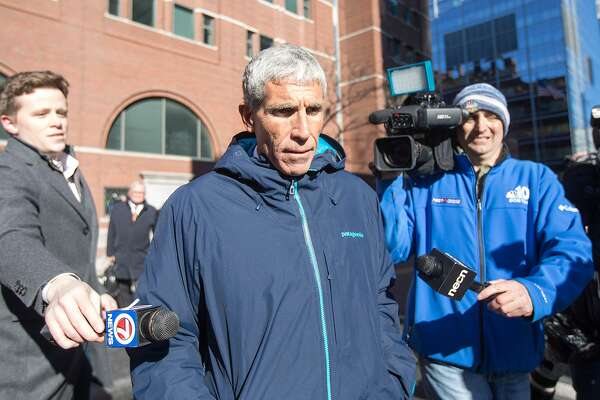 """William """"Rick"""" Singer leaves Boston Federal Court after being charged with racketeering conspiracy, money laundering conspiracy, conspiracy to defraud the United States, and obstruction of justice on Tuesday, March 12, 2019 in Boston, Mass. Singer is among several charged in an alleged college admissions scam. (Scott Eisen/Getty Images/TNS) **FOR USE WITH THIS STORY ONLY**"""