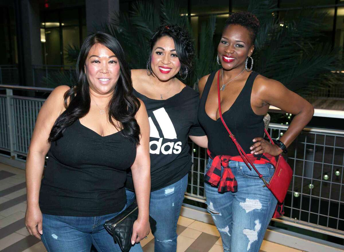 Ice Cube fans pose for a photograph before his concert at House of Blues Houston on Thursday, March 14, 2019, in Houston. Ice Cube came back to Houston in support of his 2018 album, Everythang's Corrupt.