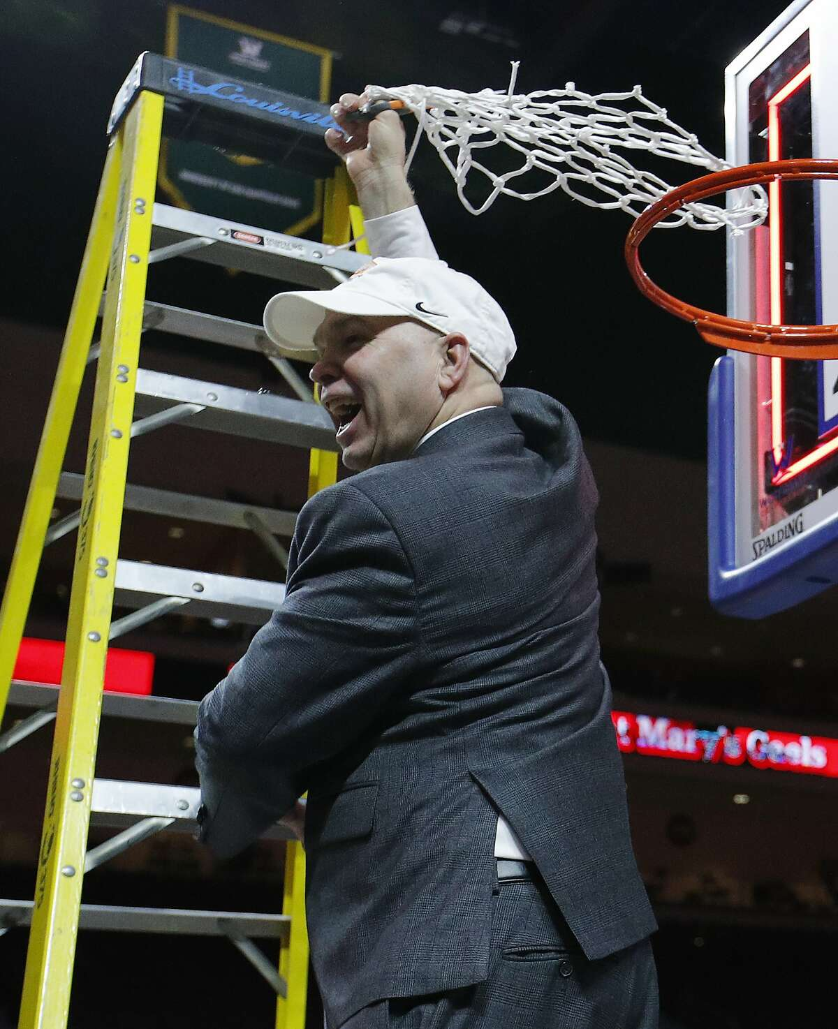 St. Mary's head coach Randy Bennett cuts down a net after his team defeated Gonzaga 60-47 in an NCAA college basketball game for the West Coast Conference men's tournament title, Tuesday, March 12, 2019, in Las Vegas. (AP Photo/John Locher)
