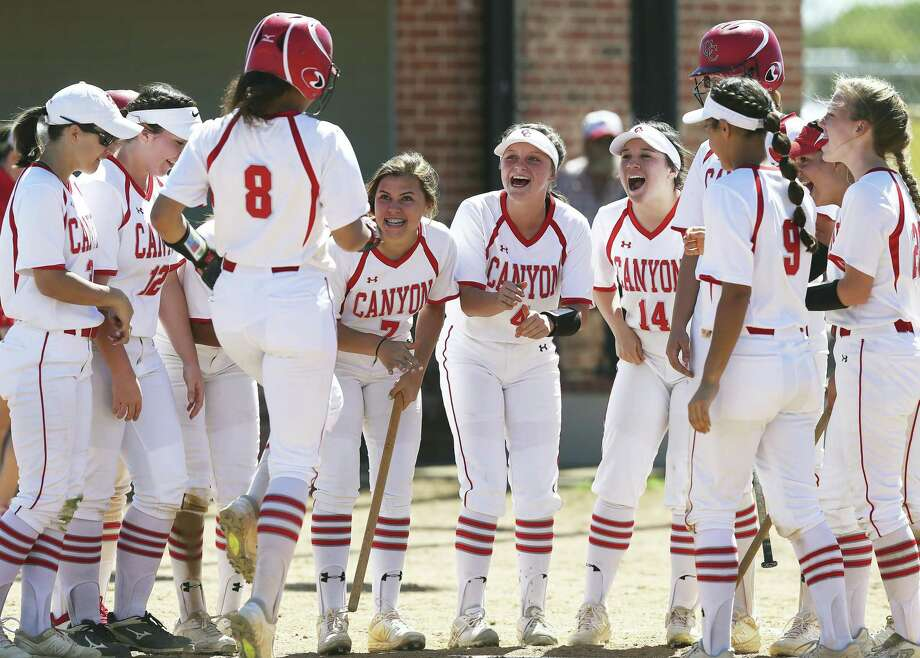 Aliyah Pritchett (8) gets a hearty welcome at home plate after homering for New Braunfels Canyon. Photo: Tom Reel / Staff Photographer / 2019 SAN ANTONIO EXPRESS-NEWS