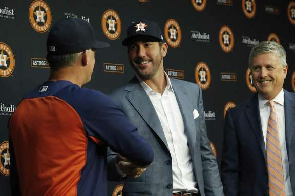 Much to the delight of manager A.J. Hinch, left, and GM Jeff Luhnow, right, a waiver trade on Aug. 31, 2017, brought ace Justin Verlander from the Tigers to the Astros, and the rest was World Series history. Effective this season, all MLB trades must be consummated by July 31.