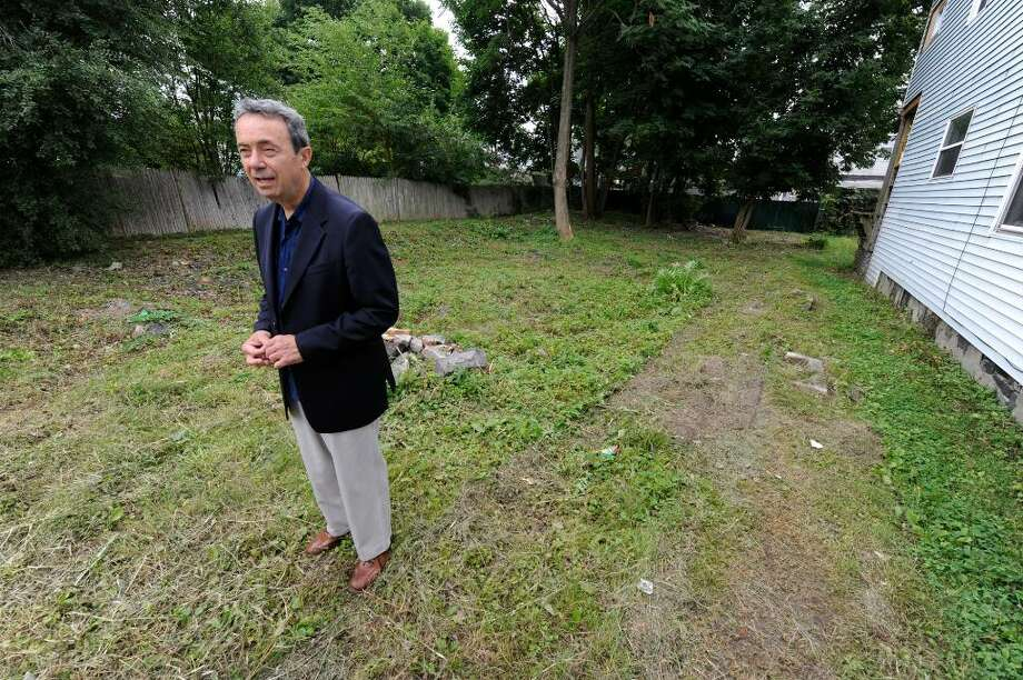 Former Cohoes Mayor Ronald Canestrari, here visiting the scene of a 1978 fatal fire, said Virginia Gratto stoked the suspicions of detectives who tried unsuccessfully to build a murder case against her. (Skip Dickstein / Times Union) Photo: Skip Dickstein