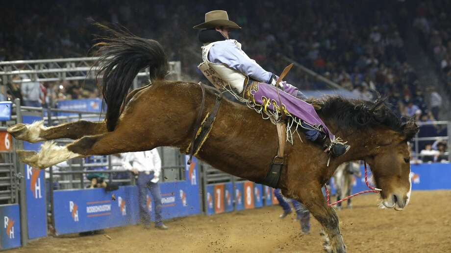 Kaycee Feild rides Betty's Boy during saddle bronc competition in the RodeoHouston Semifinal 2 at NRG Stadium on Thursday, March 14, 2019, in Houston. Photo: Brett Coomer/Staff Photographer