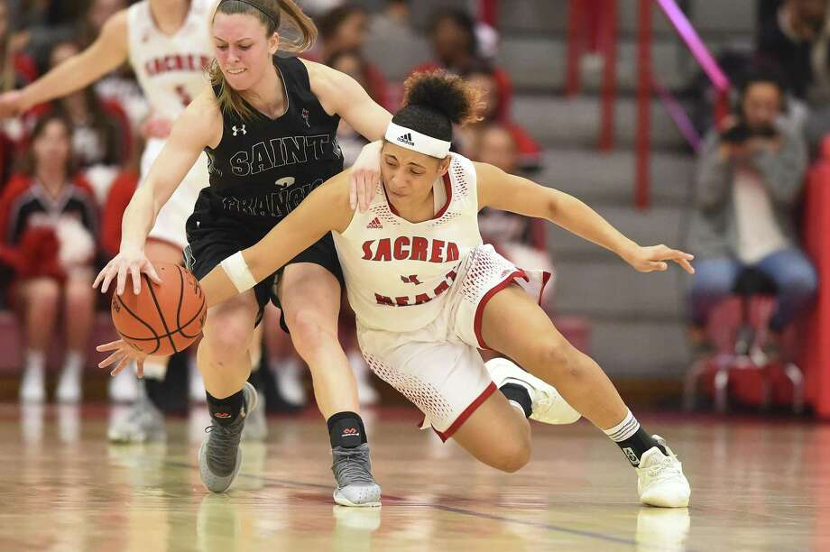 St. Francis' Karson Swogger (3) and Sacred Heart's Jayla Davis battle for a loose ball during the NEC semifinals on Thursday at the Pitt Center in Farifield. Photo: Sacred Heart University / Contributed Photo / Stamford Advocate Contributed