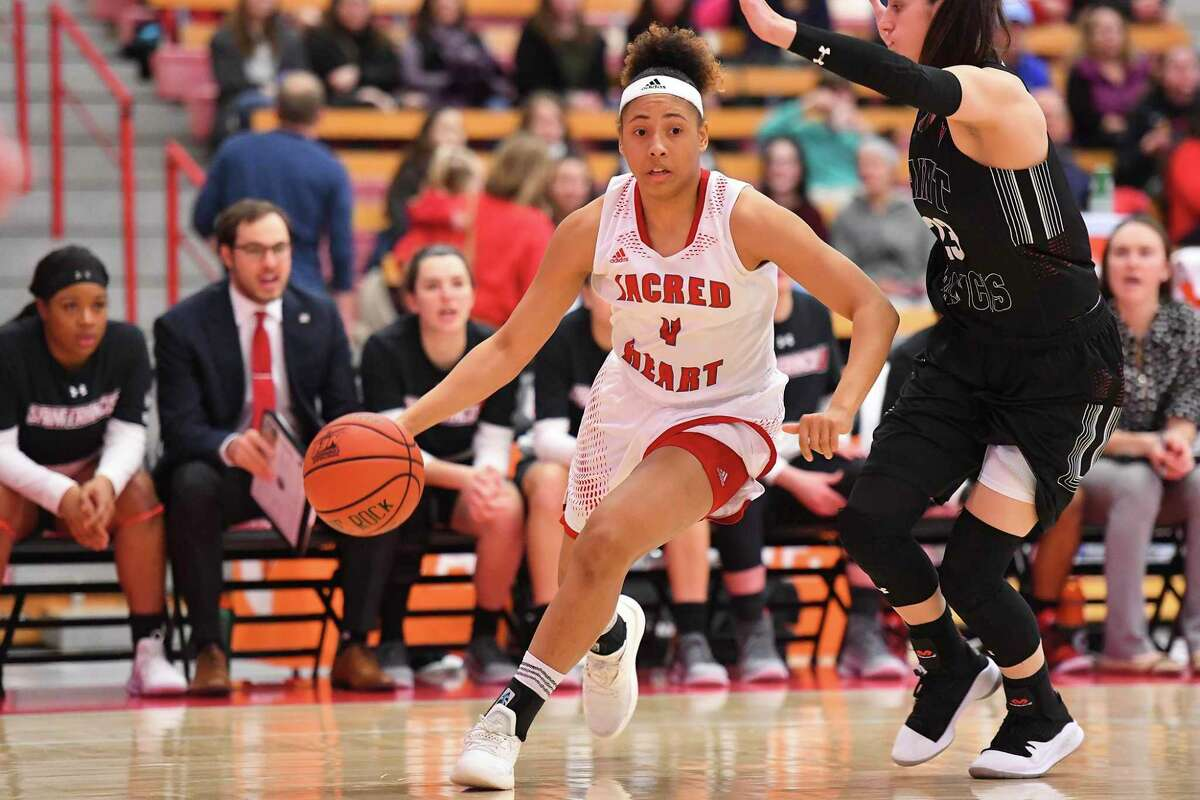Sacred Heart's Jayla Davis (4) dribbles against St. Francis during the NEC semifinals at the Pitt Center in Fairfield, Conn. on Thursday, March 14, 2019. St. Francis won 68-60.