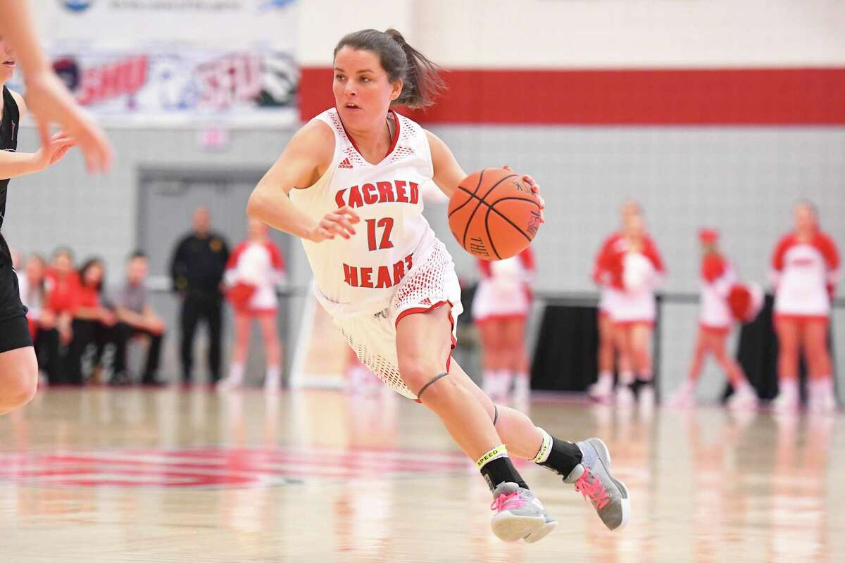 Sacred Heart's Allyson Murphy (12) dribbles against St. Francis during the NEC semifinals at the Pitt Center in Fairfield, Conn. on Thursday, March 14, 2019. St. Francis won 68-60.