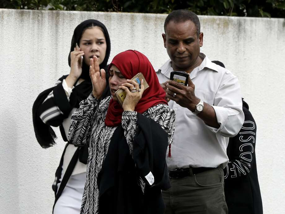 People wait outside a mosque in central Christchurch, New Zealand, Friday, March 15, 2019. Many people were killed in a mass shooting at a mosque in the New Zealand city of Christchurch on Friday, a witness said. Police have not yet described the scale of the shooting but urged people in central Christchurch to stay indoors. (AP Photo/Mark Baker) Photo: Mark Baker, Associated Press