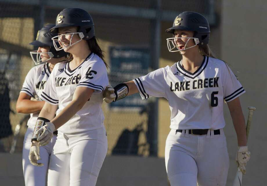 Lake Creek players share a smile during the first inning of a District 20-5A high school softball game at Lake Creek High School, Thursday, March 14, 2019, in Montgomery. Photo: Jason Fochtman, Houston Chronicle / Staff Photographer / © 2019 Houston Chronicle