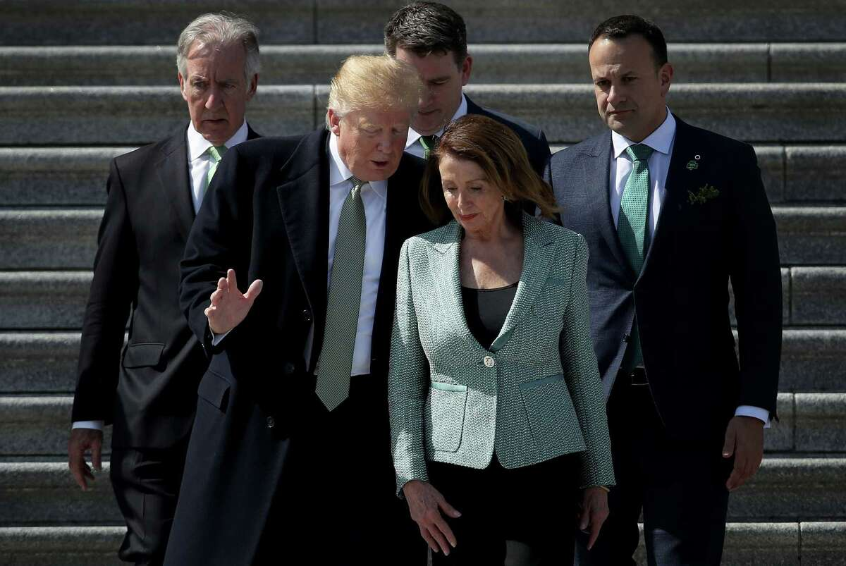 *** BESTPIX *** WASHINGTON, DC - MARCH 14: U.S. President Donald Trump confers with Speaker of the House Nancy Pelosi (D-CA) while departing the U.S. Capitol following a St. Patrick's Day celebration on March 14, 2019 in Washington, DC. Also pictured (L-R) are Rep. Richard Neal (D-MA), and Irish Taoiseach Leo Varadkar. (Photo by Win McNamee/Getty Images)