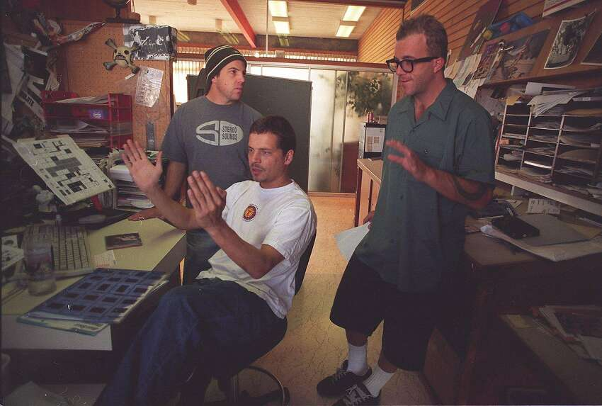 THRASHER2/19DEC95/SC/BW--Thrasher Magazine staff discuss a major layout for the next edition. l-r: Bryce Kanights, photo editor; Brian Brannon, art director; and editor Jake Phelps. By Brant Ward/Chronicle