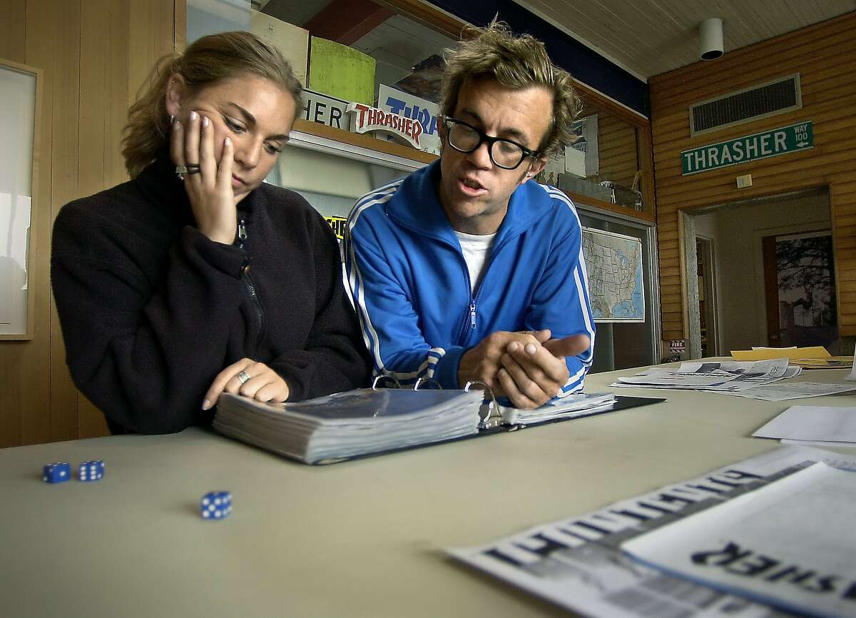 skatemag047_ch.jpg Editorial Assistant Erin Dyer working with editor in chief Jake Phelps. Feature story on magazines published in the Bay Area. Thrasher is the preeminent skateboarding magazine, published by High Speed Productions in San Francisco. Thrasher (and probably the other magazines, Slap - a skateboarding title somewhat tamer than Thrasher - and Juxtapoz, an art title) is in the final stages of production - They should be getting pages back from the printer, proofing them, checking color, etc. Idea is to see the sausage getting made, with a feel for the independent nature of the enterprise. 7/30/03 in San Francisco CHRIS HARDY/ The Chronicle