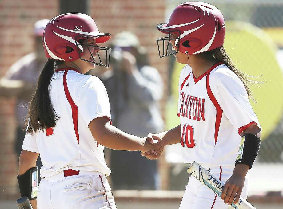 Sydney Belvin, left, is congratulated by Isabel Armendariz after putting the Cougars up again in the late innings as Canyon hosts East Central in 26-6A softball on March 14, 2019. Photo: Tom Reel, Staff / Staff Photographer / 2019 SAN ANTONIO EXPRESS-NEWS
