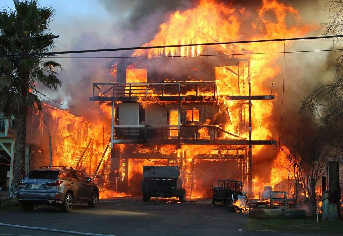 Several explosions and 20-foot flames ravaged three homes on Bethel Island while firefighters rushed to the scene and began to battle the inferno.