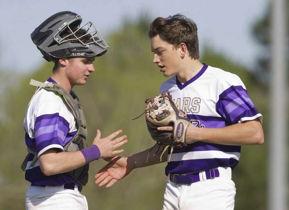 Montgomery starting pitcher Charlie Taylor (14) gets high-five from catcher Grant Brown (9). Photo: Jason Fochtman, Houston Chronicle / Staff Photographer / © 2019 Houston Chronicle
