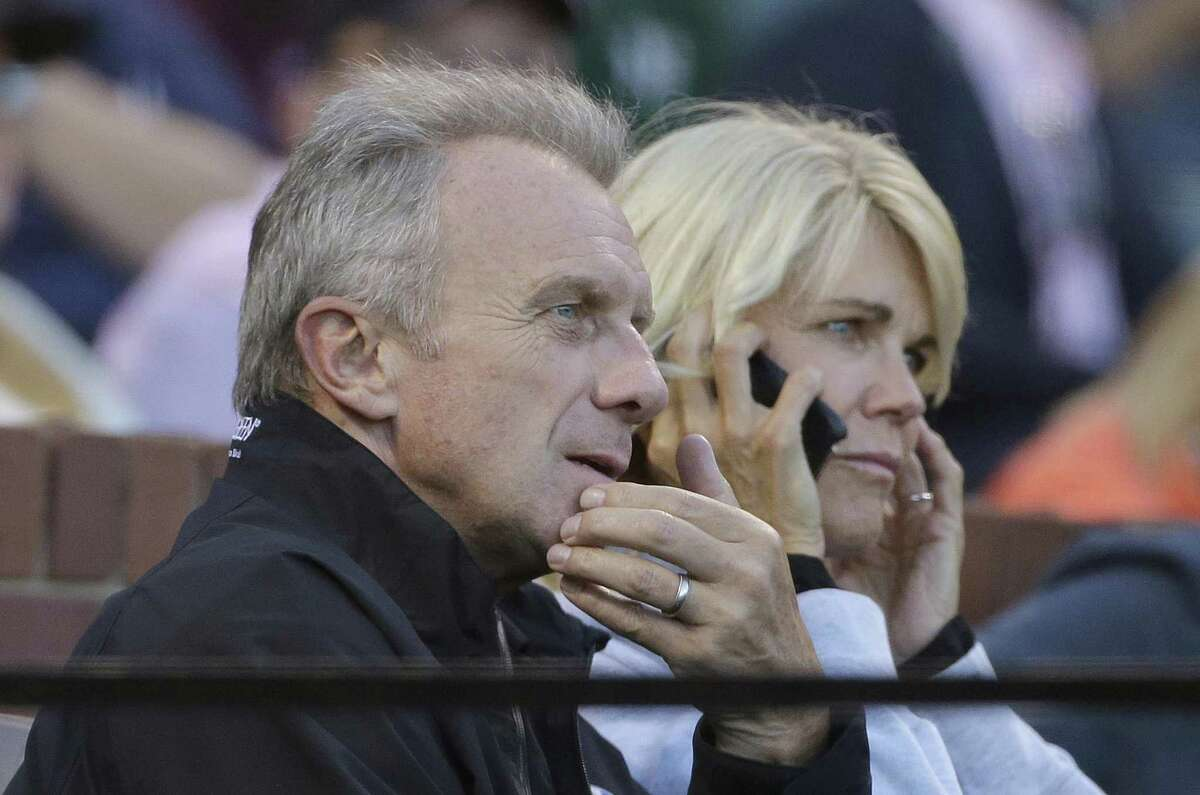 Hall of Fame football player Joe Montana, left, and his wife Jennifer watch during the third inning of a baseball game between the San Francisco Giants and the Oakland Athletics in San Francisco, Monday, June 27, 2016.