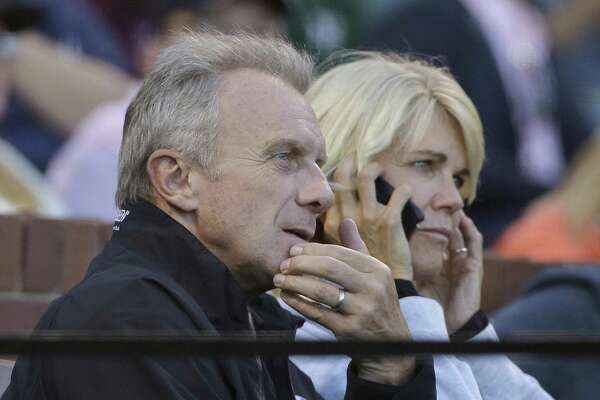 3ebf82ea225 2of4Hall of Fame football player Joe Montana, left, and his wife Jennifer  watch during the third inning of a baseball game between the San Francisco  Giants ...
