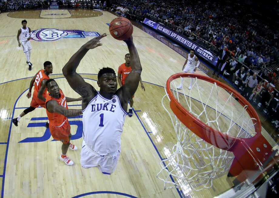 CHARLOTTE, NORTH CAROLINA - MARCH 14: Zion Williamson #1 of the Duke Blue Devils dunks the ball against the Syracuse Orange during their game in the quarterfinal round of the 2019 Men's ACC Basketball Tournament at Spectrum Center on March 14, 2019 in Charlotte, North Carolina. (Photo by Streeter Lecka/Getty Images) Photo: Streeter Lecka / 2019 Getty Images
