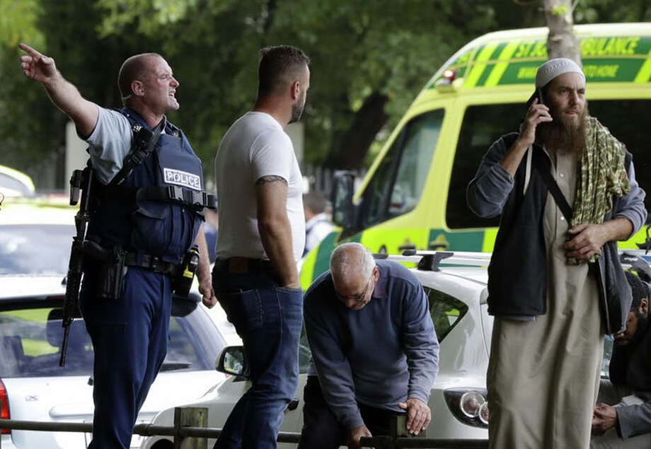 Police attempt to clear people from outside a mosque in central Christchurch, New Zealand, Friday, March 15, 2019. Many people were killed in a mass shooting at a mosque in the New Zealand city of Christchurch on Friday, a witness said. Police have not yet described the scale of the shooting but urged people in central Christchurch to stay indoors. Mark Baker ? Associated Press