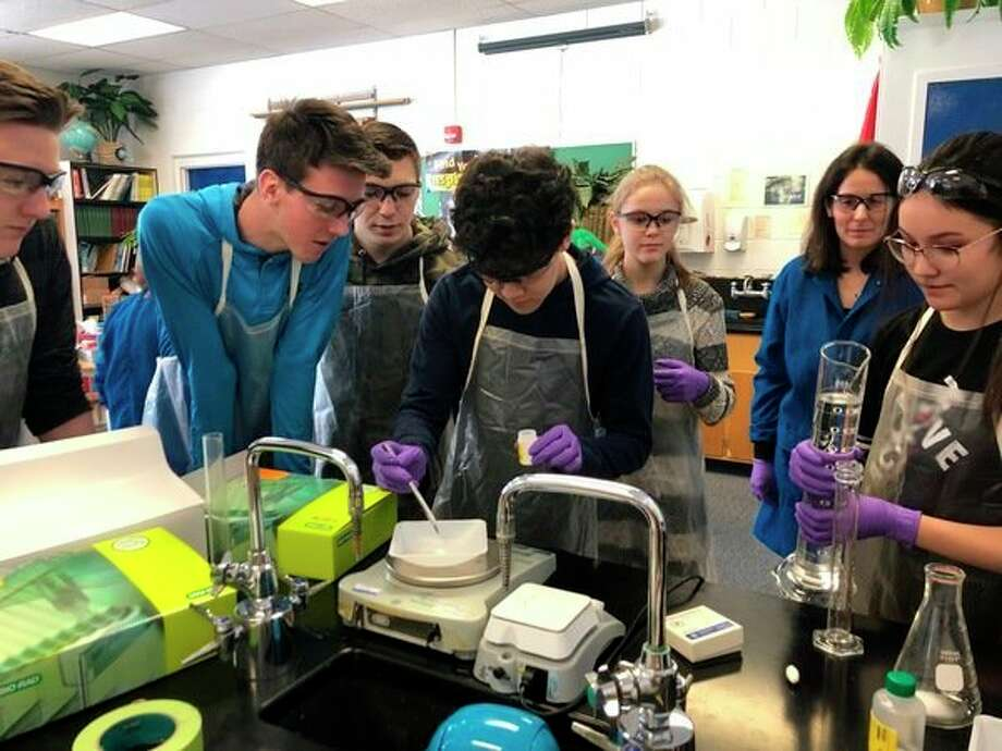 Biology students at Midland Christian School participate in a recent DNA Fingerprinting Lab led byMichigan State University faculty Lauren Aerni-Flessner and Evelyne Cudel. (Photo provided)