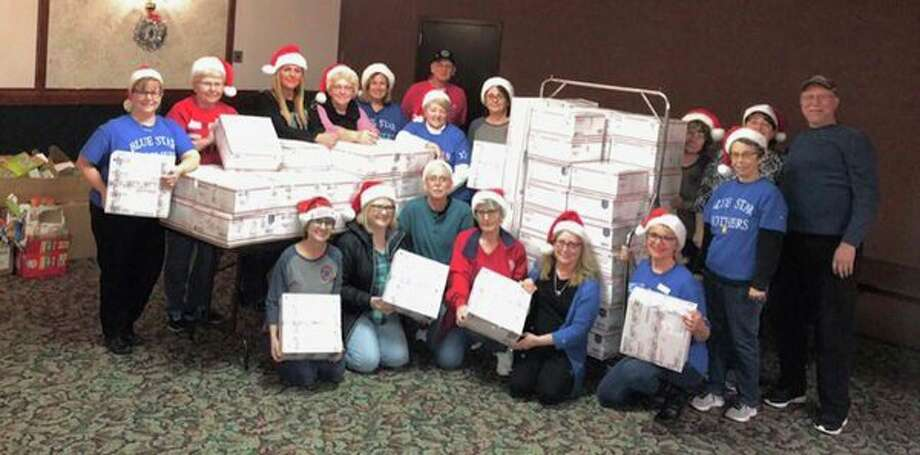 Thumb Chapter 178 of the Blue Star Mothers had a very successful Christmas packing party in November. There were 108 boxes packed. DaVita Dialysis was there to lend a hand. Pictured are Blue Star Mothers and Dads. (Submitted Photo)