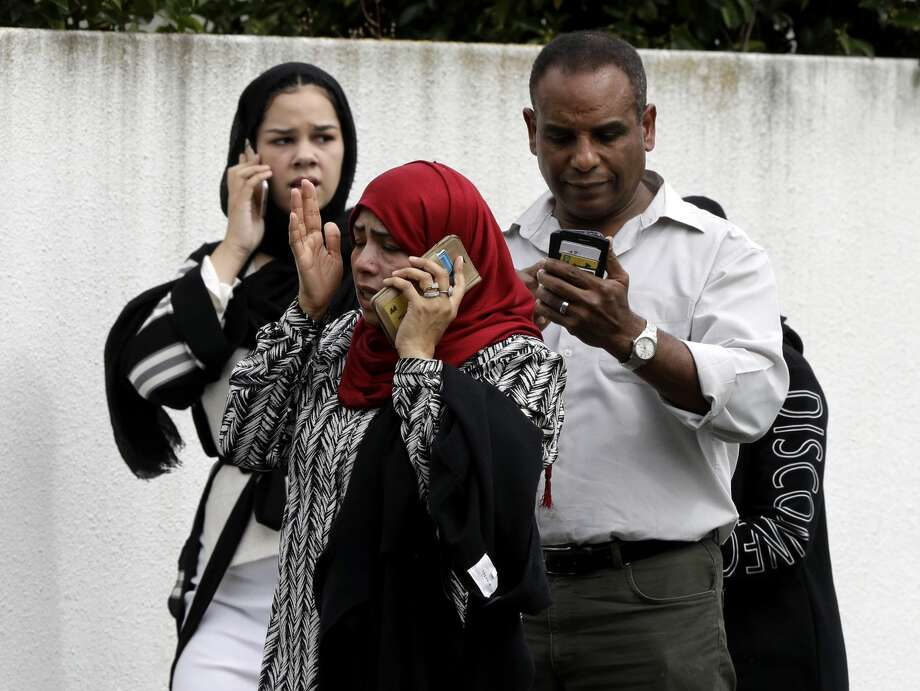 People wait outside a mosque in central Christchurch, New Zealand, Friday, March 15, 2019. Many people were killed in a mass shooting at a mosque in the New Zealand city of Christchurch on Friday, a witness said. Police have not yet described the scale of the shooting but urged people in central Christchurch to stay indoors. (AP Photo/Mark Baker) Photo: Mark Baker/AP