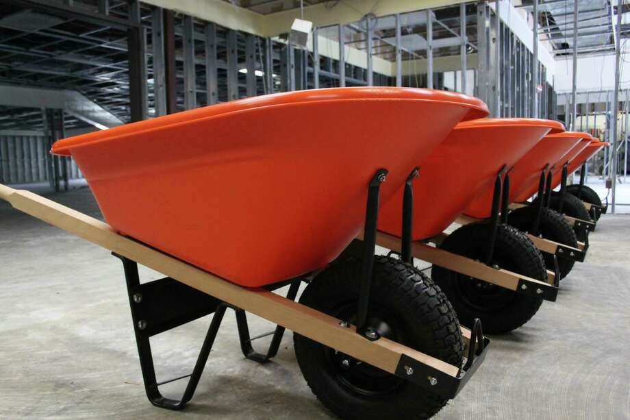 Harris County Public Library patrons can check out gardening tools such as wheelbarrows, rakes and shovels from the Baldwin Boettcher Library, which began offering a tool library starting March 1, 2019. Photo: Mayra Cruz