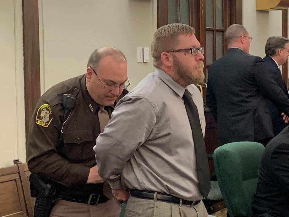 Joel Brandon Wallace is handcuffed by a court officer after being found guilty of five criminal charges, including the first degree premeditated murder of his great-aunt Victoria Kilbourne, on March 15, 2019 in the 42nd Circuit Court. Photo: Mitchell Kukulka