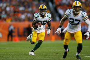 DENVER, CO - AUGUST 26:  defensive back Kentrell Brice #29 of the Green Bay Packers runs with the football after intercepting a pass as Josh Jones #27 looks to block in the first quarter during a Preseason game against the Denver Broncos at Sports Authority Field at Mile High on August 26, 2017 in Denver, Colorado. (Photo by Justin Edmonds/Getty Images)