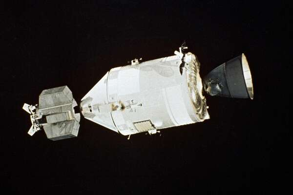 The American Apollo spacecraft as seen in Earth orbit in July 1975 from the Soviet Soyuz spacecraft during the joint U.S.-USSR Apollo-Soyuz Test Project docking mission. The special docking module attached to the Apollo capsule was specifically designed to allow the two spacecrafts to join in orbit. (U.S.S.R. Academy of Science)