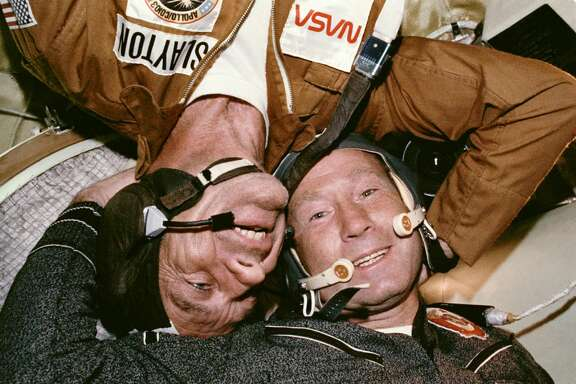 "Astronaut Donald ""Deke"" Slayton and Cosmonaut Aleksey A. Leonov in the Soyuz orbital module in July 1975 during the joint U.S.-USSR Apollo-Soyuz Test Project docking in Earth's orbit mission."