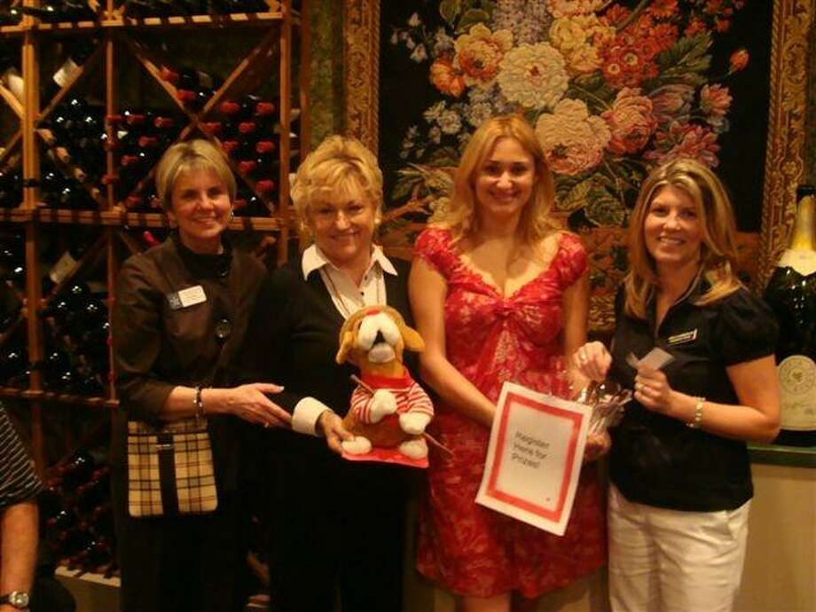 From left, Diane Blanco from Lone Star College-Kingwood, Sharon Lewis from Kingwood Travel, Hazel Morrett with Trafalgar Tours and Ann Chamberlain with Kingwood Travel recently hosted a document party at Amedeoâ??s wine room for a group of prominent Kingwood citizens going to tour Italy over spring break. / Internal