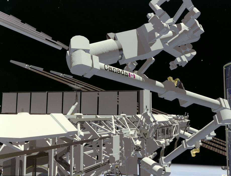 "(February 6, 1998) --- ISS  CANADIAN SSRMS ART CONCEPT --- This  artist's concept depicts the Canadian Space Station Remote Manipulator System (SSRMS) mechanical arm aboard the International Space Station (ISS). Attached to the end of the arm is the Special Purpose Dexterous Manipulator (SPDM) or ""Canada Hand"" also being developed for the station. Canada is developing a second generation of space robotics for the ISS that will be a key component for the  station's assembly and maintenance. The stationmechanical arm is scheduled to be launched in