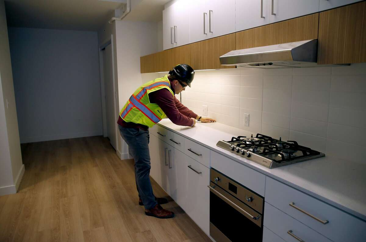 Roman Speron, president of developer Align Residential, inspects a kitchen in a nearly completed one-bedroom unit at The Landing apartment complex under construction in the Dogpatch neighborhood of San Francisco, Calif. on Wednesday, March 13, 2019. Up to 20 percent of the tenants in the 263-unit complex will be allowed to rent their apartments or rooms through Airbnb.