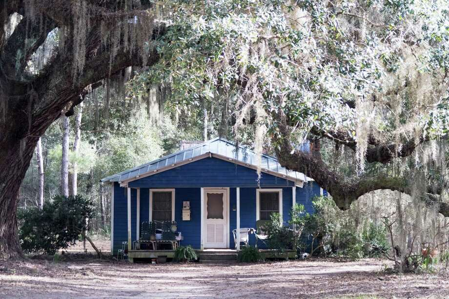 """A traditional Gullah home on Daufuskie Island, S.C., is painted """"haint blue."""" """"Haint"""" is the Gullah pronunciation of """"haunt."""" The color is meant to keep evil spirits away. Photo: Photo For The Washington Post By Dina Mishev / Dina Mishev"""