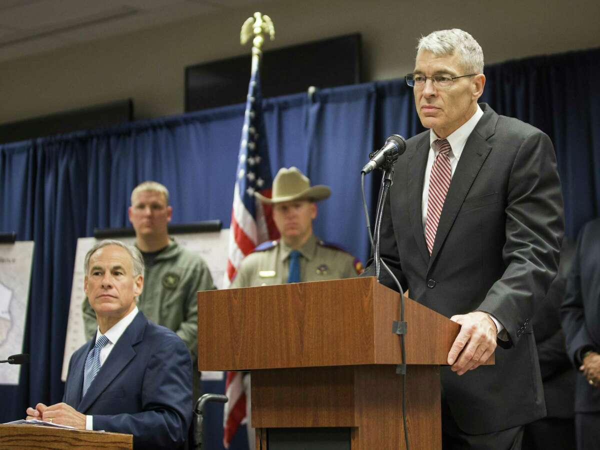 Steve McCraw, right, director of the Texas Department of Public Safety, with Gov. Greg Abbot, left, on Monday, April 10, 2017, in Houston. ( Marie D. De Jesus / Houston Chronicle )